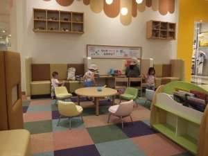 Rest area for toddlers with books and large magnet pieces and magnet board