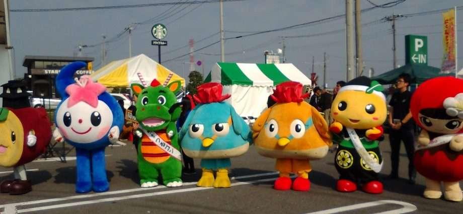The rainbow towns mascots in the car park of Cainz Super Mall Kawajima Interchange