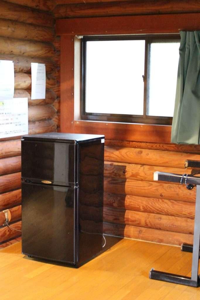 Midorinomura camp site fridge and kotatsu in room