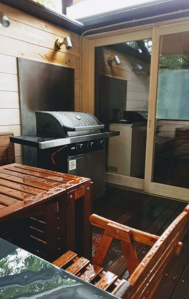 Outdoor barbecue on deck in glamping cabins comoriver