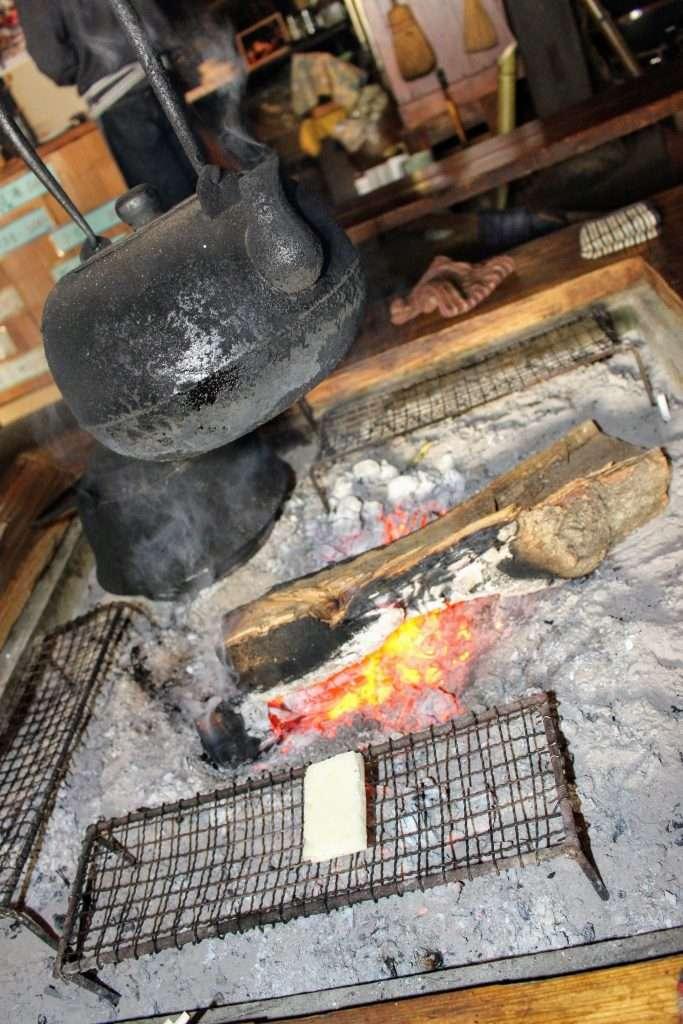 Mochi grilling on an open fire