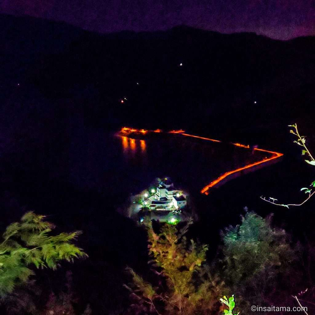 shimokubo dam lit up at night