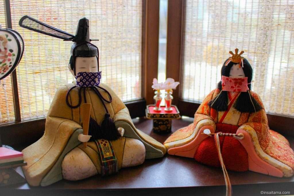 emperor and empress hina dolls wearing masks
