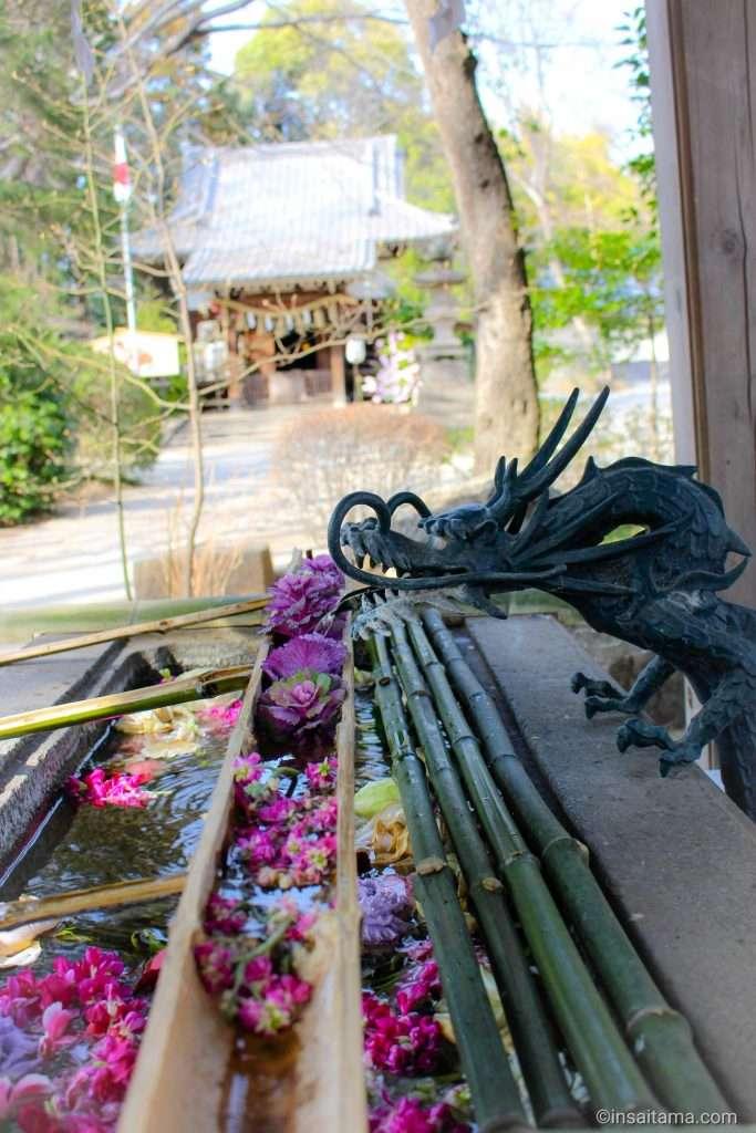 Floral water font at Takao Hikawa Shrine