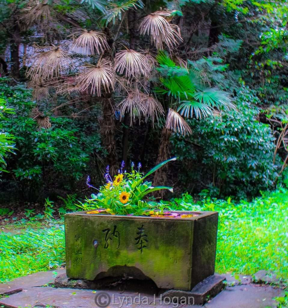 floral font in the wood of Sakitama Shrine Gyoda